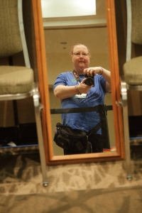 Self-portrait near the dress up corner (now with official event photographer on the badge)